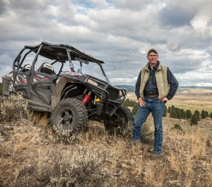 In this Sept. 21, 2017 photo provided by Silvies Valley Ranch, Colby Marshall, vice president of Silvies Valley Ranch poses for a picture in Burns, Ore. (David Zaitz/Silvies Valley Ranch via AP)