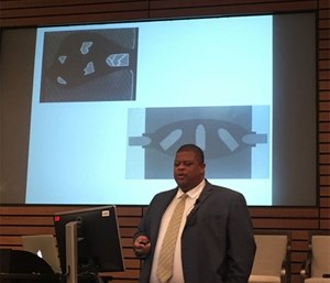 Gladden speaking on the cavity created by a bullet, using pictures originally created by Norman McSwain. (Photo by Catherine R. Counts)