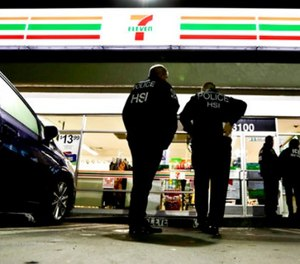 U.S. Immigration and Customs Enforcement agents serve an employment audit notice at a 7-Eleven convenience store Wednesday, Jan. 10, 2018, in Los Angeles. (AP Photo/Chris Carlson)
