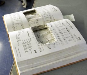 A hymnal with the pages cut to hide a cell phone in Bordentown, N.J. (AP Image)