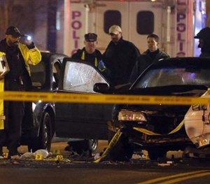 Law enforcement officers investigate the scene involving at least one wrecked DC Metro police car Thursday. (AP Image)