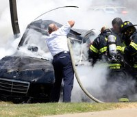Firefighters rescue man, boy after fiery crash