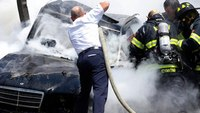Firefighters rescue man, boy after fiery crash