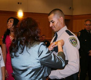 In this Oct. 31, 2013, photo released by Dona Ana County Sheriff shows officer Jose Chavez at his graduation ceremony from our Law Enforcement Academy in Las Cruces, N.M.