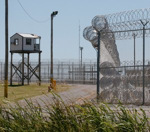 A tower is pictured outside of the razor wire at the Great Plains Correctional Facility in Hinton, Okla.