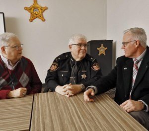 Three Franklin County chaplains, Rev. David Murdoch (left) Rev. Leo Connolly and Rev. Tim Womack discuss the role of chaplains in law enforcement. Connolly is leading the new seven-person team.