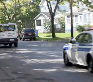 In this image taken from video provided by WHAM-TV 13, in Rochester, N.Y., police pursue a van, Wednesday, Oct. 10, 2018, in Rochester. Police killed the driver in a shootout during the chase. (Will Morgan/WHAM-TV 13 via AP)