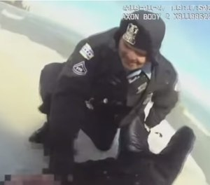 Chicago officers rescuing a man who jumped in the icy Lake Michigan to save his dog (Photo/ Associated Press via YouTube)
