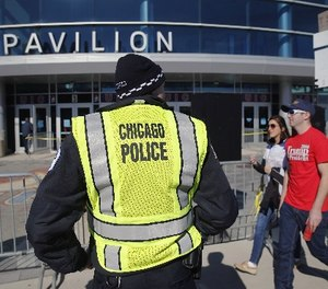 A Chicago police officer stands his post outside the University of Illinois-Chicago Pavilion, Friday, March 11, 2016, in Chicago.