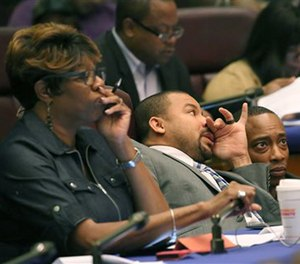 Aldermen Pat Dowell, third from left, Michael Scott Jr., and Gregory Mitchell, listen to testimony during committee hearings Tuesday, Oct. 4, 2016, at City Hall in Chicago. (AP Photo/Chicago Tribune)