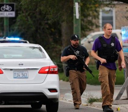 Police: Suspect in cop shooting, bike attack captured