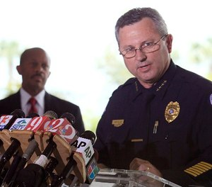 In this March 22, 2012 file photo, Sanford Police Chief Bill Lee speaks to the the media during a news conference as city manager Norton Bonaparte Jr. listens at left, in Sanford Fla.