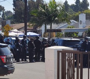 Police gather in Southcrest, Calif. where a 10-year-old child holed up in a shed and fired off two rounds from a shotgun Thursday morning, San Diego police said. (Photo/TNS)