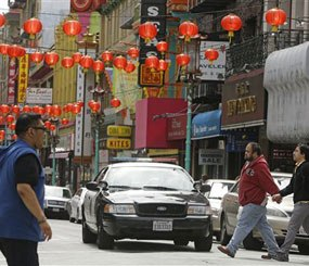 San Francisco police patrol the Chinatown district Thursday, March 27, 2014, in San Francisco.