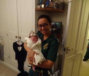 Paramedic Chloe Civil holds newborn Holly Chloe. (Northampton Chronicle Facebook photo)