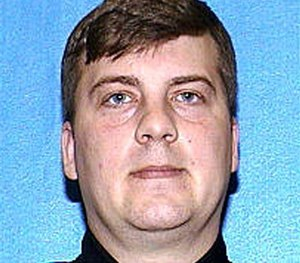 This file photo provided by the Milwaukee Police Department shows Christopher Manney who was fired from the Milwaukee Police Department in connection with the shooting and killing of Dontre Hamilton, a mentally ill man in a downtown park in April. (AP Image)