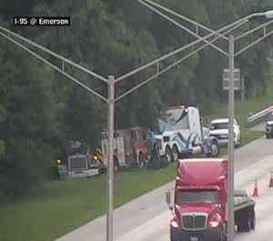 A Florida Department of Transportation camera captured images of a Jacksonville fire engine being towed after overturning on the side of the highway.