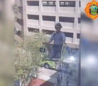 Video: Fla. fire crew raises ladder to visit firefighter recovering from COVID-19