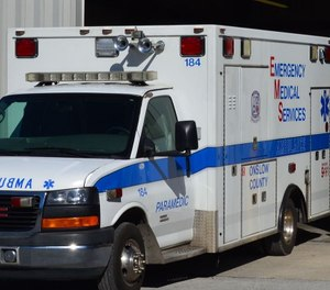 An Onslow County EMS ambulance caught fire Tuesday morning, causing one paramedic to suffer smoke inhalation.