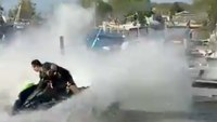 Watch: Off-duty NY firefighter puts out boat fire using Jet Ski