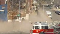 Video: Near miss for pedestrians, fire truck as DC building collapses