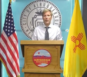 Albuquerque Mayor Tim Keller speaks at a news conference on Friday, June 12. Keller has proposed a new public safety department that would send social workers and other specialists on some 911 calls instead of fire/EMS responders and police.