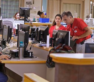 The emergency department at Tufts Medical Center in Boston is centered around a hub, where the staff works to manage the flow of patients. (Rick Wood/Milwaukee Journal Sentinel)