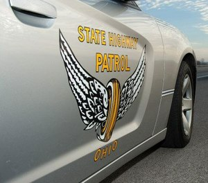 Ohio state troopers say two pedestrians were fatally struck by a fire apparatus at a fire scene on Thursday.