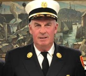 The Rockport Board of Selectmen voted to terminate Fire Chief James Doyle amid an ongoing dispute between volunteer firefighters and town officials, including a lawsuit filed by 11 Rockport residents against the town.