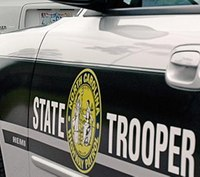 Woman run over by apparatus responding to fatal crash