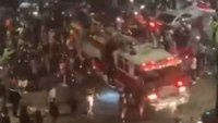 Video: Large crowd surrounds, climbs on responding Calif. fire engine