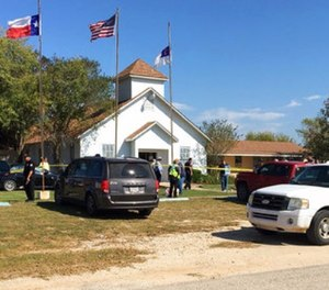 Emergency personnel respond to a fatal shooting at a Baptist church in Sutherland Springs, Texas, Sunday, Nov. 5, 2017.
