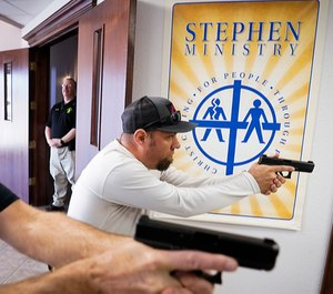 Jason Johnston, right, and Les Davis practice searching and clearing a hallway during a Sheepdog Defense Group armed security training program at Cornerstone Community Church in Springtown, Texas.