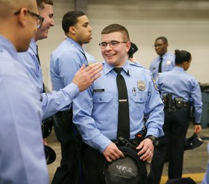 Benson Churgai, 24, is the first openly-transgender recruit to graduate from the Philadelphia Police Academy. (Photo/TNS)