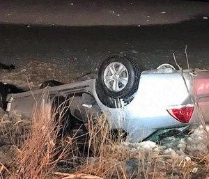 The overturned vehicle.