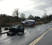Paramedics injured, motorist killed in Wash. ambulance crash