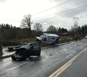 A vehicle collided with an AMR ambulance in Clark County, Washington, on Tuesday, injuring two paramedics and killing the other driver, officials said. (Photo/Clark County Sheriff's Office)