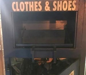 Firefighters rescued a woman from a clothing donation bin after she had been trapped inside for three days. Police say it is the third time the same woman has been trapped inside a clothing donation bin. (Photo/Paterson Police Department)