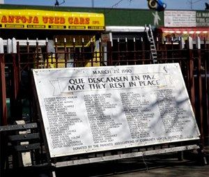 The names of those who were killed in the Happy Land social club fire are displayed in a small park across the street from the former club's location. (AP Photo/Seth Wenig)