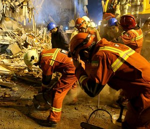 Iranian firefighters start to dig a tunnel to make a corridor under the 17-story Plasco building which collapsed after being engulfed by a fire. (AP Photo/Ebrahim Noroozi)