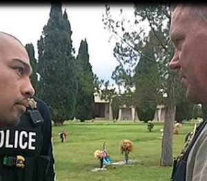 This Sept. 16, 2014 photo provided by the Cottonwwood, Ariz., Police Department shows Cecilio Cruz, left, and Cottonwood, Ariz., police Sgt. Tod Moore at a funeral home and cemetery in Tucson, Ariz., on Tuesday, Sept. 16, 2014.