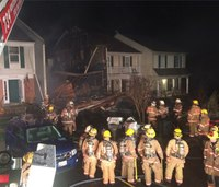 8 firefighters hurt in townhouse fire collapse