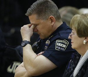 Brian McPike, the chief of the University of Colorado-Colorado Springs police force, attends a vigil on campus, Nov. 28, 2015.