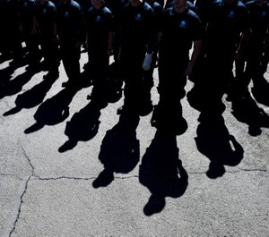 Cadets stand at attention during the Colorado Law Enforcement Memorial ceremony at the Colorado State Patrol Academy in Golden, Colo. (Photo/TNS)