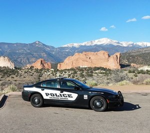 A cruiser in front of Garden of the Gods with Pikes Peak rising in the distance in Colorado Springs, Colorado.