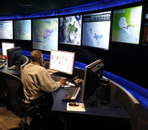 C4I is best achieved in a joint environment such as a command and control center where local government and allied agencies can interact and then collectively react to changing conditions. (AP Photo/Gary Malerba)