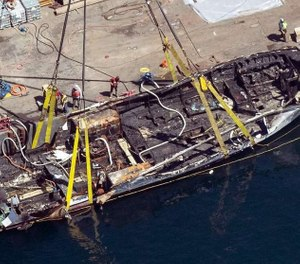 In this Sept. 12, 2019, photo, the burned hull of the dive boat Conception is brought to the surface by a salvage team off Santa Cruz Island, Calif. The crew aboard the Southern California scuba dive boat had not been trained on emergency procedures before the deadly fire broke out last year, killing 34 people in one of the state's deadliest maritime disasters, according to federal documents released Wednesday. (Photo/Brian van der Brug, Los Angeles Times via AP)