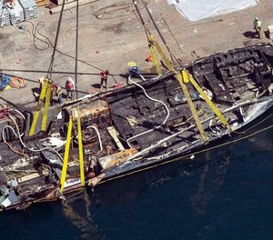 In this Sept. 12, 2019, photo, the burned hull of the dive boat Conception is brought to the surface by a salvage team off Santa Cruz Island, Calif. The crew aboard the Southern California scuba dive boat had not been trained on emergency procedures before the deadly fire broke out last year, killing 34 people in one of the state's deadliest maritime disasters, according to federal documents released Wednesday.