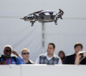 A Parrot AR Drone 2.0 is seen flying during a demonstration at the Consumer Electronics Show, Wednesday, Jan. 9, 2013, in Las Vegas. (AP Photo/Julie Jacobson)