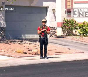 This Sept. 22, 2016, photo from video from KTNV 13 Action News shows Conor Climo during an interview while walking a Las Vegas neighborhood, heavily armed.
